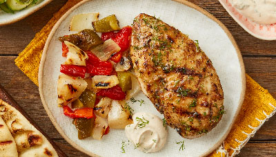 Grilled Tahini Garlic Chicken with Bell Peppers and Onions