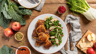 Harissa Chicken Thighs and Kale-Fennel Salad with Pomegranate, Apple and Toasted Pepitas